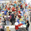 Hundreds of volunteers in the last of four volunteer shifts help package more than 280,000 meals to be delivered to Haiti during the Victory 4 Haiti event on Saturday at Victory.<br /> Globe | Laurie Sisk