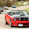 A caravan of Mustangs makes its way down historic Route 66 east of Carterville on Thursday in celebration of the American muscle car's 50th Anniversary.<br /> Globe | Laurie Sisk