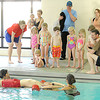 From the left: Briana Wilson, Karsten Creech and Shelby Wilson lead a demonstration on lifeguarding the April Pool's Day on Tuesday night at the YMCA's South Branch.<br /> Globe | Laurie Sisk