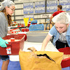 From the left: Eden Laws, 13 and Amy Koch, 16, help clean after one shift and set up for the next during the Victory 4 Haiti event on Saturday at Victory.<br /> Globe | Laurie Sisk