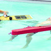 From the left: Shelby Wilson, Karsten Creech and Briana Wilson lead a demonstration on lifeguarding the April Pool's Day on Tuesday night at the YMCA's South Branch.<br /> Globe | Laurie Sisk