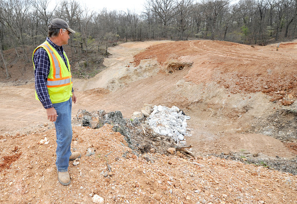Gary Oplotnik, superintendent for A&M Engineering, stands Thursday  near an area contaminated with lead and zinc that is being capped with clay at Tanyard Hollow.<br /> Globe | Laurie Sisk