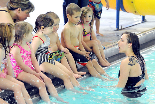 Joplin Family YMCA Swim Lessons Coordinator Lauren Thompson explains what will take place as children embark on what for many would be their first swim lessons during the April Pool's Day on Tuesday night at the YMCA's South Branch.<br /> Globe | Laurie Sisk