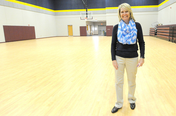 Cecil Floyd Elementary Principal Gayle Hennessey stands in the nearly completed safe room at her school. Hennessey said several community members have already been trained to assist in the event of serious weather. The grand opening for the gym will be April 30, with a magic show, hot dogs and reading activities.<br /> Globe | Laurie Sisk