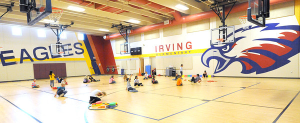 Irving Elementary srtudents get ready for the start of P.E. class on Thursday in Irving's safe room.<br /> Globe | Laurie Sisk
