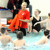 Joplin YMCA lifeguard Kenny Braun talks about the importance of lifejackets during the April Pool's Day on Tuesday night at the YMCA's South Branch.<br /> Globe | Laurie Sisk