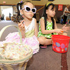 From the left: Four-year-old Elliana Reed and seven-year-old Kate Dimabuyu enjoy the treats they collected at the Christ's Community United Methosist Church Easter Egg Hunt on Saturday morning at the church.<br /> Globe | Laurie Sisk