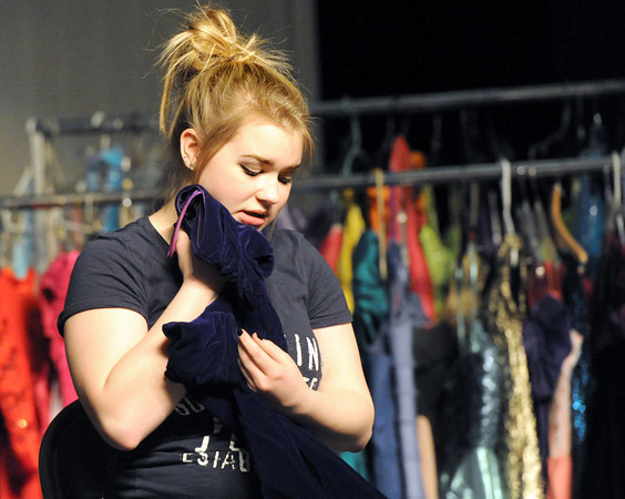 "Pittsburg High School thespian Arianna Daniels clutches firmly to a dress she wants during a Pittsburg High School rehearsal for ""Snowflakes,"" a social-issues play centering around the distinct challenges of  autism.<br /> Globe 