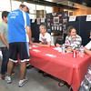 Workers check in the last shift of volunteers for the Victory 4 Haiti event on Saturday at Victory.<br /> Globe | Laurie Sisk