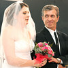 Schandera Jordan breathes a heavy sigh as her father, Chris White, walks her down the aisle to renew her vows during an emotional ceremony on Saturday at The Christman Event Center. Jordan was recently diagnosed with an aggressive form of cancer and one of her bucket list items was a full-blown wedding ceremony to her husband of seven years.<br /> Globe | Laurie Sisk