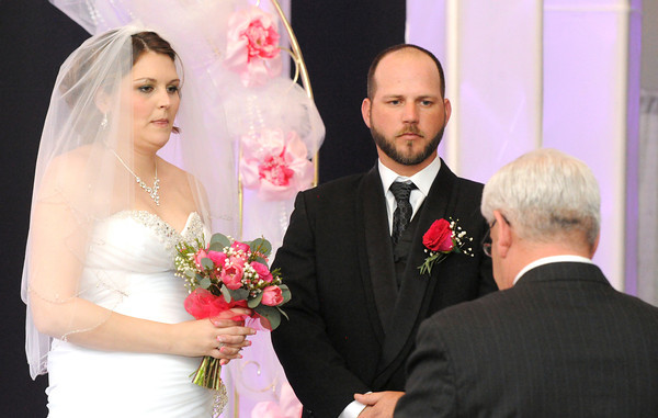 Schandera and Jonathan Jordan renew their vows before Pastor Kent Hogan during an emotional ceremony on Saturday at The Christman Event Center. Jordan was recently diagnosed with an aggressive form of cancer and her top bucket list item was a full-blown wedding ceremony to her husband of seven years.<br /> Globe | Laurie Sisk