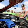 Brett Butler, of Webb City smiles as he talks about the 64,000 miles on his 1969 Mustang Mach1. Butler said the car was the ultimate muscle car in 1969.<br /> Globe | Laurie Sisk