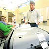 David Austin casts his vote in the April local elections at the Donald E. Clark Public Safety and Justice Center on Tuesday. Workers at the center, which housed the 1st and 8th precincts, reported a high voter turnout.<br /> Globe | Laurie Sisk