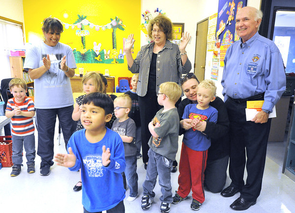 An exuberant Gerrardo Gomez, front center, helps his fellow preschoolers celebrate a $2,172.18 donation to Cerebral Palsy of Tri-County Missouri (CPC) in Webb City on Thursday. The money was raised by the Knights of Columbus 42nd Annual Tootsie Roll Drive for Persons with Developmental Disabilities. Presenting the check to Executive Director Christy Graham (center back row) was St. Marys' KOC Grand Knight Denny Desmond, pictured right. The funds will be used for resurfacing the playground area at the center and also will help in improving the facility's heat and air conditioning system.<br /> Globe | Laurie Sisk