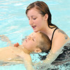 Joplin Family YMCA Swim Lessons Coordinator Lauren Thompson helps six-year-old Otto Fuchs stay afloat during swim lessons at the April Pool's Day on Tuesday night at the YMCA's South Branch.<br /> Globe | Laurie Sisk