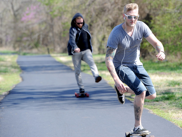 Travis Edwards, front and Vincent Cash enjoy a little skateboarding on a trail adjacent to Shoal Creek on Wednesday. Improving Missouri's trails are also being considered by the state.<br /> Globe | Laurie Sisk