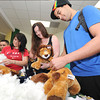 From the left: Lindy Braund, Commerce, Okla. senior; Rachel Whitehead, Seneca senior and Trever  Montgomery, Joplin senior stuff toy lions during the Campus Activities Board's Build A Lion event at the Billingsley Student Center at Missouri Southern on Wednesday. CAB provided about 200 lions for MSSU students.<br /> Globe | Laurie Sisk