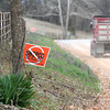 A sign placed by the grassroots group Save the Ozarks rests near the site of a proposed SWEPCO powerline project.<br /> Globe | Laurie Sisk