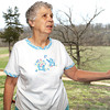 xxx xxx stands on her front porch, which overlooks an area near a SWEPCO porposed powerline project in Bentonville, Ark.<br /> Clobe | Laurie Sisk