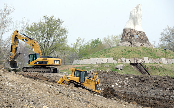 Crews continue filling a large pit on Thursday at King Jack Park in Webb City, the site of the famous Praying Hands sculpture. The project is expected to take about three months.<br /> Globe | Laurie Sisk