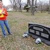 Sheila Lynch Calix stands near her father's grave in a neighborhood cemetery located near the site of a proposed SWEPCO powerline. Calix said perserving the sanctity of the site is something her father would have wanted.<br /> Globe | Laurie Sisk