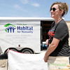 Hilary Wehmeyer, one of nine volunteers from Thrivent, a St. Louis-based financial group, fills her tool belt after lunch on Saturday at 1814 West Fourth St. <br /> Globe | Laurie Sisk