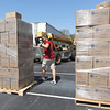 Will Combs, of Lifeline Christian Mission, shrink wraps a pallet of 14,256 meals for delivery during the Victory 4 Haiti event on Saturday at Victory. twenty palletscontaining 285,120 meals will be shipped to help feed Haitian chilfren.<br /> Globe | Laurie Sisk