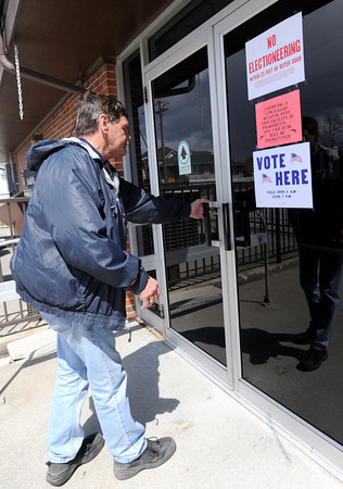Jay White enters the Senior Center to cast his votes on Tuesday in the April local elections. Election workers at the center, which housed the 16th and 18th precincts, reported a high voter turnout on Tuesday.<br /> Globe | Laurie Sisk