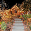 Thousands of sparking lights adorn the walkway to the front door of the Jack and Becky Walling home inside the Oak Pointe subdivision. The display features a specatacular light display that homeowner Jack Walling installed himself.<br /> Globe | Laurie Sisk