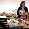 BEN GARVER — THE BERKSHIRE EAGLE	<br /> Sue Turner sorts books for the St. Vincent de Paul and St. Ann's tag sale that is part of the St. Ann's Parish festival Saturday and Sunday.  Funds from  the festival will go towards restoration of the churches and the Lenox Food Pantry.