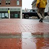BEN GARVER — THE BERKSHIRE EAGLE<br /> A man crosses the Crosswalk on North Street and School Street in the rain, Monday, July 24, 2017.