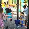 BEN GARVER — THE BERKSHIRE EAGLE<br /> Children kick off the summer parks program on the playground at Durant Park, Monday, July 8, 2019. <br /> Summer Parks Playground Program will be held at The Common, Durant Park, and Springside Park at Springside Avenue for six weeks through Aug. 16.
