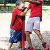 BEN GARVER — THE BERKSHIRE EAGLE<br /> Jeniel Santiago Ortiz, 6, and Yariel Flores, 12, get a strong start to his summer parks program on the playground at Durant Park, Monday, July 8, 2019. <br /> Summer Parks Playground Program will be held at The Common, Durant Park, and Springside Park at Springside Avenue for six weeks through Aug. 16.