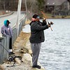 BEN GARVER — THE BERKSHIRE EAGLE<br /> Tara Taliaferro and her partner Crystal Taylor fish for rainbow trout on Onota Lake in Pittsfield, Tuesday, April 9, 2019. Most of the lake ice is out in Onota, with Pontoosuk following behind with much more ice.  The couple practice catch-and-release techniques.