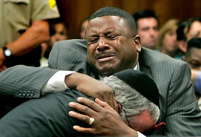 (San Bernardino) Ex deputy Ivory John Webb Jr. cries uncontrollably after being found not guilty in a San Bernardino court room. He hugs his attorney Michael Schwartz.