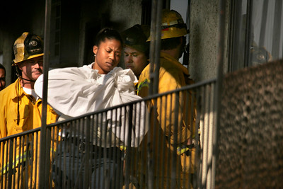(Cudahy-Los Angeles)  The coroner removes the body of a 4 year-old girl who had become trapped in a burning apartment building. She was found dead at the scene.  The apartment fire occurred on the 5000 block of Clara Street in Cudahy.