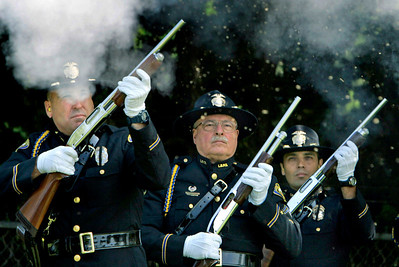 "(Santa Ana)    From left----  Members of the Long Beach Police Department's Honor Guard, Darren Adams, Cpl. Bob ""Helmet"" Schroeder, (C.Q.) and Keith McCart perform a 21- gun salute during the funeral of Santa Ana police Deputy Chief Bruce Carlson.  Carlson  died of cancer  at the age of 55 and served in the Santa Ana Police Department from 1973 until his death.  The service was held at  Calvary Church of Santa Ana and then a procession of officers followed to the Fairhaven Memorial Park."