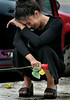 "(Laguna Hills)     Rooshi Yaghobi cries at the spot where Parees Ghassemian, 18, of Laguna Niguel, died at the scene of the accident on Paseo de Valencia.   He was her "" brothers best friend"" she said.  Arya Asgarynejad, who was driving a 2002 Mercedes-Benz CLK 55, was arrested on suspicion of vehicular manslaughter and operating a vehicle with gross negligence, causing death, said Jim Amormino of the Orange County Sheriffs Department."