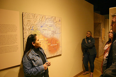 Dina Verlarde speaks to a Chadron State College group during a tour of the Museum of Indian Arts and Culture in Santa Fe, N.M. in March 2017. Verlarde, a member of  the Jicarilla Apache tribe, explained artifacts dealing with shelter, food gathering and preparation, clothing, art and rituals. (Courtesy photo)