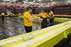 CSC Dining Services staff set up containers of lettuce as the construction of an attempt at the world's longest taco line commences in the Chicoine Center Friday, April 21, 2017, during Spring Daze. (Photo by Tena L. Cook/Chadron State College)