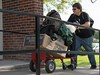 Jarrod Paul of Gordon, Neb., pushes a cart of his belongings up the ramp to Brooks Hall during Chadron State College New Student Orientation move in Thursday, Aug. 17, 2017. (Tena L. Cook/Chadron State College)