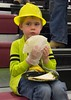 Fox Crofutt, son of Heather and Keith Crofutt, takes his first bite of one of the 2,017 tacos in the CSC attempt at a world record taco line in the Chicoine Center Friday, April 21, 2017. (Photo by Tena L. Cook/Chadron State College)