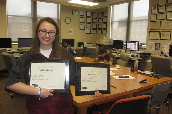 "Jordyn Hulinsky, editor of ""The Eagle"" since 2015, poses with two of the 2017 first place award certificates the Chadron State College student newspaper earned from the Nebraska Collegiate Media Association. (Courtesy photo)"