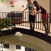 Chadron State College Summer Upward students London Gillam, left, and Kayla Shoeneberg test parachutes by dropping them from the third floor balcony of the Math and Science building Thursday, June 22, 2017. (Photo by Tena L. Cook/Chadron State College)