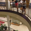 Chadron High School student Kayla Schoeneberg, left, tests a parachute she made in Chadron State College's Summer Upward Bound program by dropping it from the third floor balcony of the Math and Science building. Jen Balmat, instructor of the science class, center, watches on with Emajen Goings, right, Thursday, June 22, 2017. (Photo by Tena L. Cook/Chadron State College)