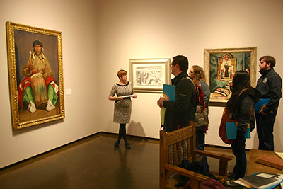 Chadron State College students and faculty tour the New Mexico Museum of Art in Santa Fe in March 2017. The tour is led by Rebecca Aubin, center, head of education and visitor experience at the museum. (Courtesy photo)