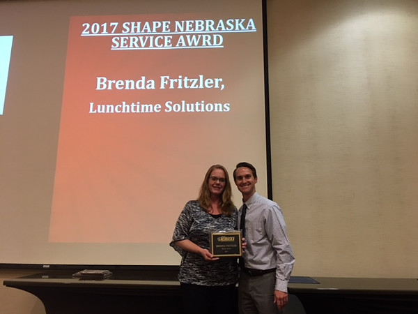 Chadron State College alumna Brenda Fritzler, left, is recognized as the 2017 Nebraska SHAPE Service Award recipient during the SHAPE Conference, Monday, Nov. 6, 2017, in Lincoln, Neb. (Courtesy photo)