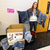 Carl Junction High School student Amber Campbell poses Wednesday at CJHS with some of the more than 100 pairs of jeans she has collected for Aeropostale's Jeans 4 Teens progrm, which distributes them to local homeless youth.<br /> Globe | Laurie Sisk