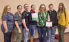 The Chadron State College Art Guild was honored as a Community Benefactor for its work the past three years with artVenture by Girl Scout Spirit of Nebraska Tuesday, Nov. 10, 2015. From left, Teena Redfern of Chadron, Victoria Lawler of Worland, Wyoming, Kevin Kubo, of Chadron, Emily Linegar of Hemingford, Nebraska, Heather Clark of Spearfish, South Dakota, Matthew Ellis of Alliance, Nebraska, and Dr. Mary Donahue, CSC art faculty member and guild adviser. (Tena L. Cook/Chadron State College)