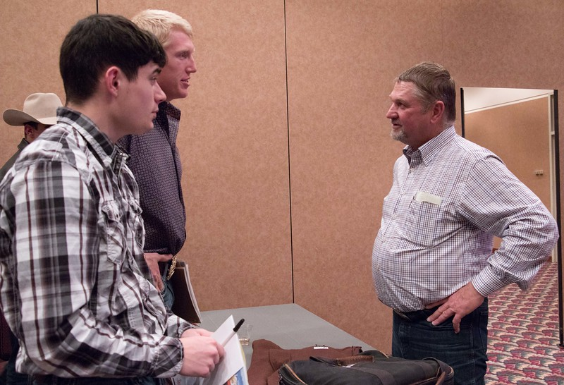 Chadron State College students Dusty Runner of Cambridge, Nebraska, left, and Will Krause of Canyon Lake, Texas, center, speak with Tony Malmberg, left, following his presentation about holistic range management Monday, November 9, 2015. (Tena L. Cook/Chadron State College)